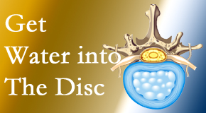 Manchester Chiropractic & Sports Injuries uses spinal manipulation and exercise to boost the diffusion of water into the disc which helps the health of the disc.